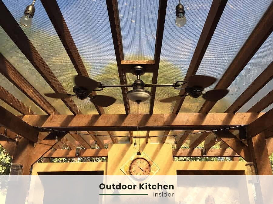 outdoor kitchen fan and lightning pergola covering