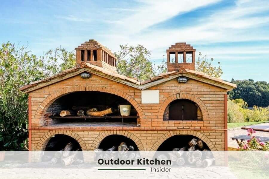 Rustic outdoor kitchen with grill and pizza oven