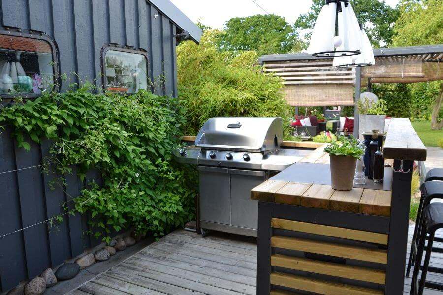 a small l-shaped outdoor kitchen with bar
