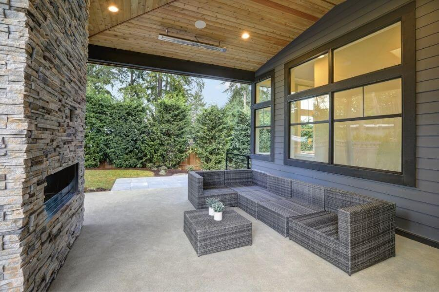 modern patio with an outdoor fireplace