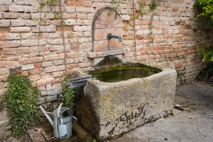 Outdoor sink made out of stone and bricks
