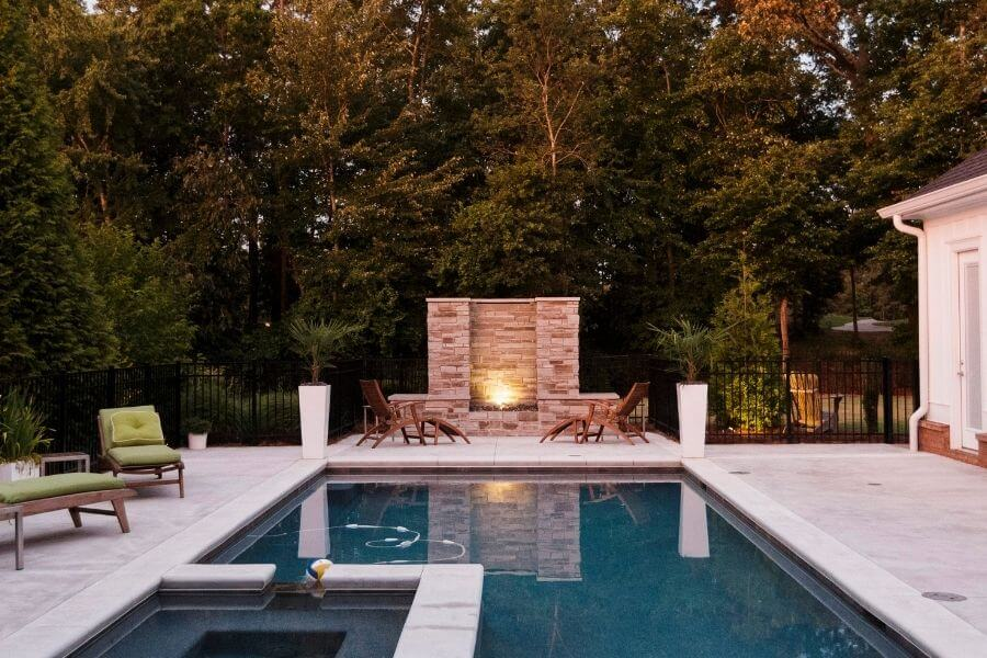 working stone fireplace swimming pool