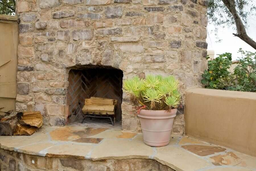 Outdoor fireplace ideas: traditional stone fireplace with shelf
