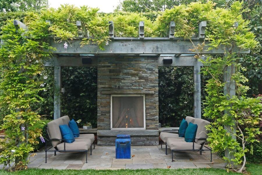 Outdoor fireplace ideas: pergola patio with stone fireplace