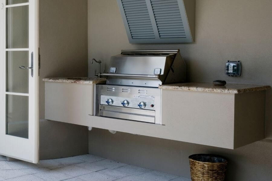 outdoor kitchen on a budget next to the house