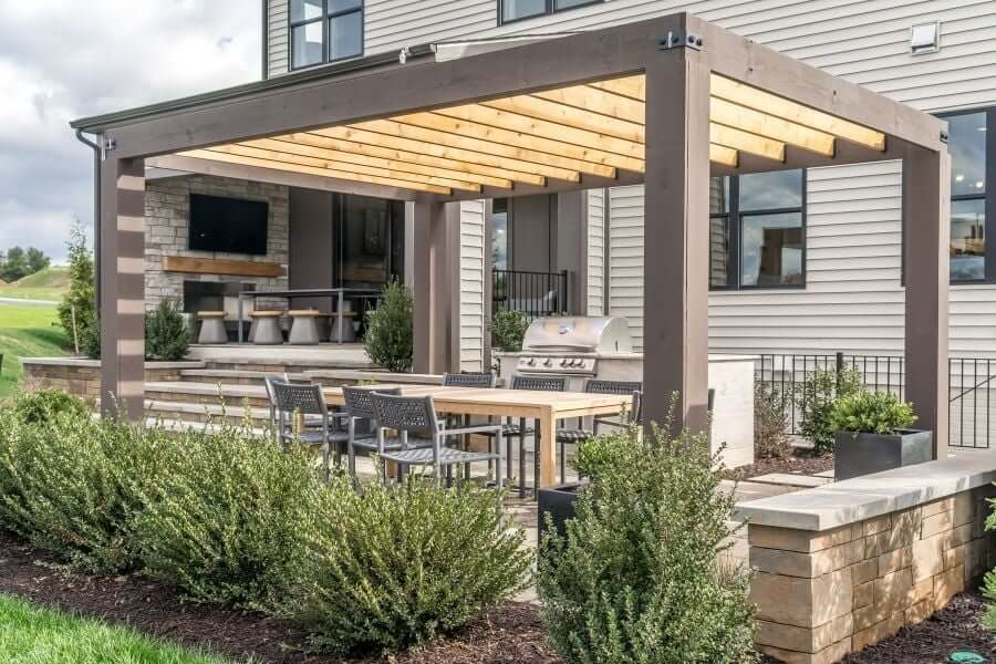 Small outdoor kitchen with pergola on the patio