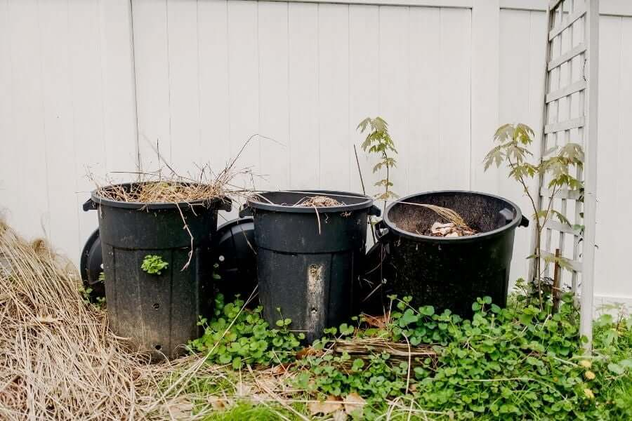 How do you make a simple compost bin with a plastic bucket?