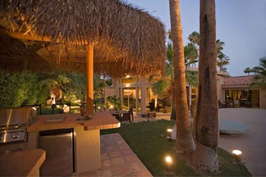 An outdoor kitchen bar with cabana