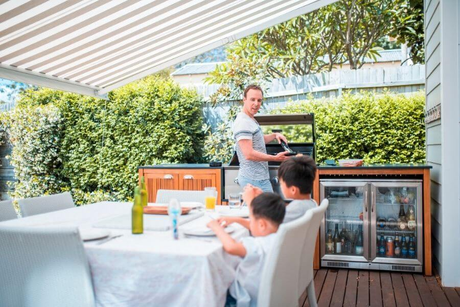 deck outdoor kitchen covered with awning