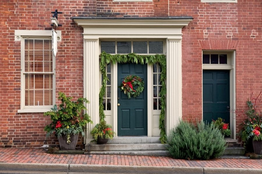 Ideas for Christmas Front Door Decorations  garland wreath planters red bow
