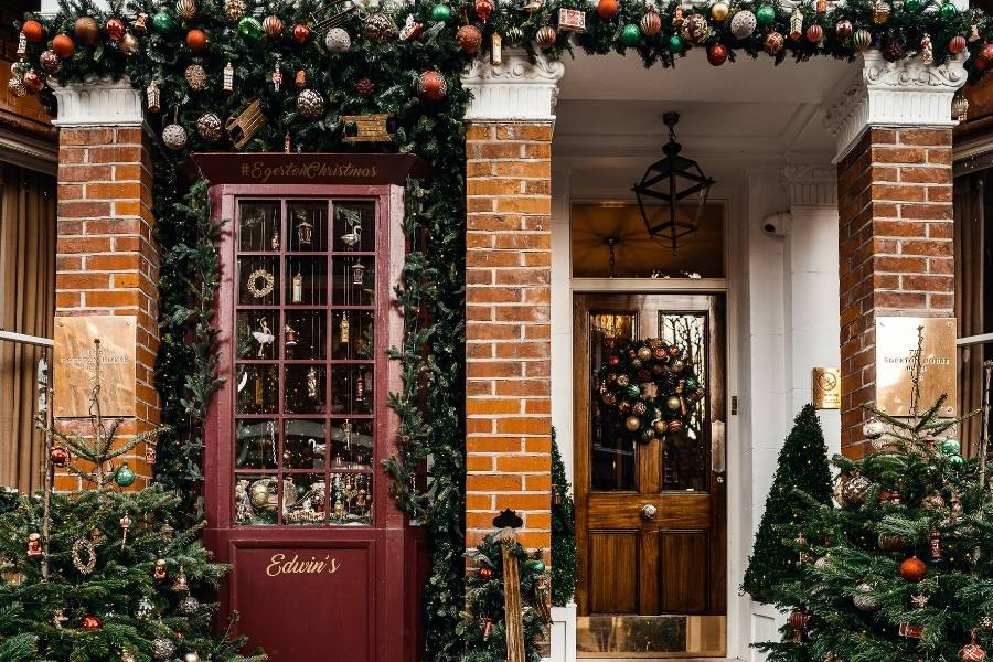 Ideas for Christmas Front Door Decorations garlands wreath, trees with plenty of Christmas ornaments including baubles