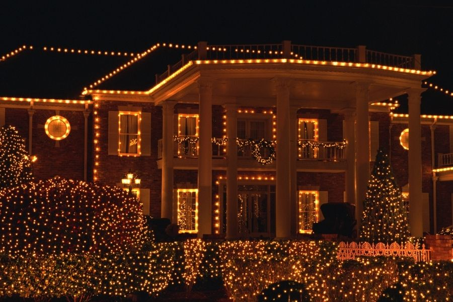 An impressive mix of outdoor  Christmas  lights on a facade and in the garden